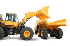 Wheel loader loading dumper Stock Photo
