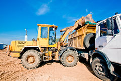 Wheel Loader Machine Loading Dumper Truck Royalty Free Stock Image
