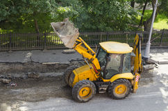 Wheel loader machine on the road. Stock Photo