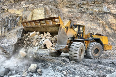 Wheel loader machine unloading rocks Royalty Free Stock Image
