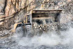 Wheel loader machine unloading rocks Stock Images