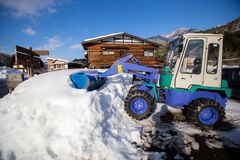 Wheel loader machine unloading snow. Removes snow on streets Stock Photography