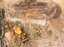 Wheel loader machine working at construction site, aerial view stock photography