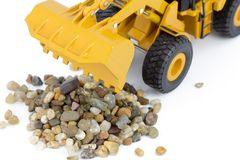 Wheel loader and pebbles Stock Images