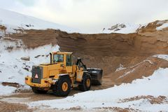 Wheel Loader at Sand Pit in Winter Royalty Free Stock Photography