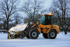 Wheel Loader Snow Removal in the Evening Stock Images