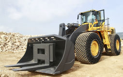 Wheel loader on a stone mine. Lateral view of a wheel loader on a stone mine Royalty Free Stock Photo