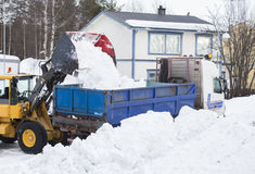 Wheel loader unloading snow Stock Images