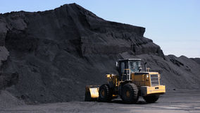Wheel loader working in a coal yard Royalty Free Stock Photography