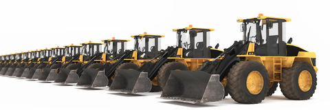 Wheel loaders parked in a row Royalty Free Stock Images