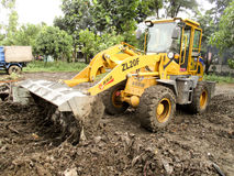 Wheel loaders. Were leveling land in the city of Solo, Central Java, Indonesia Royalty Free Stock Images
