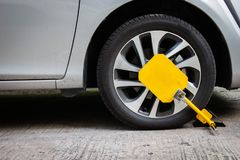 Wheel lock for anti-theft with the car on the road. Wheel lock for anti-theft with the car on the road or concrete floor royalty free stock images