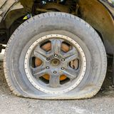 Wheel is lowered in consequence of the inactivity of the car, age, cut or puncture tires. tire work royalty free stock images