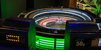 Wheel and machines. A auto roulette wheel and gaming machines stock image