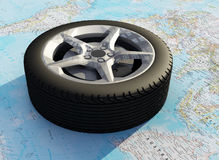 Wheel  on the  map. Stock Photos