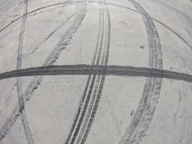 Wheel marks on concrete and on the pavement after drifting on a sunny day stock image