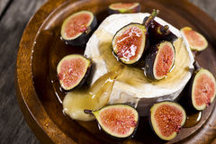 Wheel of Melted Brie Cheese with Figs and Honey Stock Photography