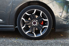 Wheel of modern car on black steel disc Stock Images