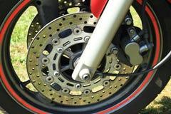 Wheel of motorbike. Wheel with grey metal brakes on modern motorbike Royalty Free Stock Photography