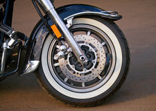 Wheel of the motorcycle. The front tire of a parked custom motorcycle royalty free stock image