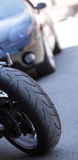 Wheel of motorcycle background on car Royalty Free Stock Images