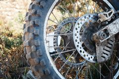 Wheel motorcycle Enduro is dirty on the grass close up Stock Photos