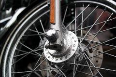 Wheel motorcycle, Harley Davidson. Harley Davidson motorcycle wheel close-up in the rain Stock Photography