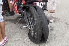 Wheel of motorcycle snapped. At Motor Show Royalty Free Stock Image