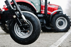 Wheel of new red agricultural seeder close up view Royalty Free Stock Photo