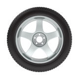 The wheel with a new tire on a white Royalty Free Stock Image