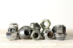 Wheel nuts that are belonging to the automotive industry Stock Image