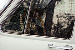 The wheel of the old car behind the glass. A piece of gray retro car stock photo