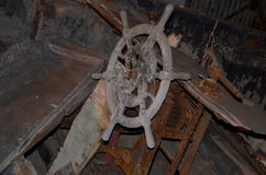The wheel of an old ship. Wheel of an old ship in an abandoned ship Stock Photography