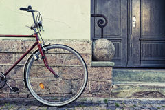 Wheel parked near the wall stylish bike Stock Photos