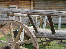 Wheel and part of the wooden waggon near windmill Royalty Free Stock Images