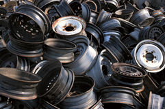Wheel pile. A pile of rims in a junkyard royalty free stock photography