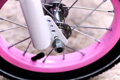 Wheel of a pink bicycle Stock Image