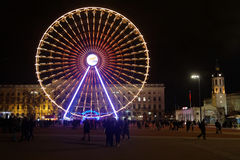 The wheel on Place Bellecour. LYON, FRANCE, December 8, 2015 : With numerous small lights, the festival of lights 2015 pays tribute to the victims of the attacks Royalty Free Stock Photo