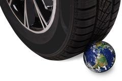 Wheel pressing globe Stock Photography