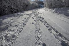 Wheel print in the snow/road/street/snow. stock photo