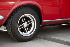 Wheel of a red classic car. Royalty Free Stock Photography
