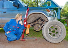 Wheel replacement at the car Stock Images