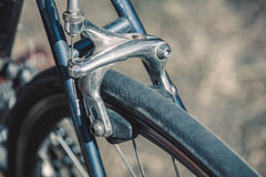Wheel of retro sports bike with the brakes. Close-up Royalty Free Stock Photos