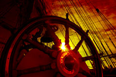 Wheel and rigging of a sailing ship Stock Photo