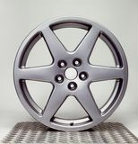 Wheel rim in grey back Stock Photography