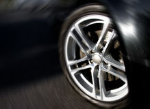 Wheel Rim in Motion. Closeup photo of the front car rim, with a radial motion effect Royalty Free Stock Images
