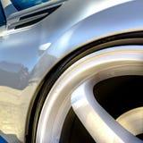 Wheel rim with white spokes on a shiny white car stock photo