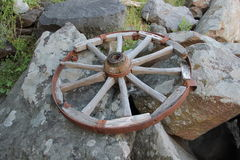 Wheel on the rock Stock Photography