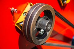 Wheel roller mechanism with strap timing belt on industrial vehicle machinery. Close up royalty free stock photos