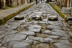 Wheel ruts of wagons on ancient streets of Pompei stock image